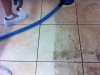 Using grout brush to agitate the floor